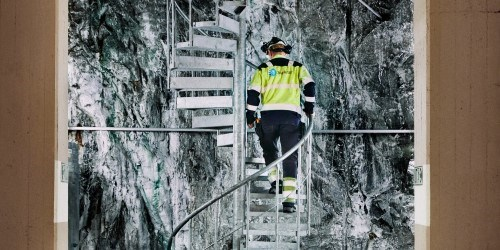 Statkraft employee walking up stairs in hydropower plant